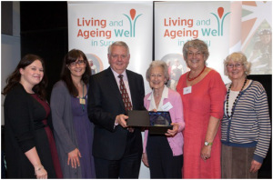 Councillor Mel Few presents Surrey Libraries with the Help at Home Award