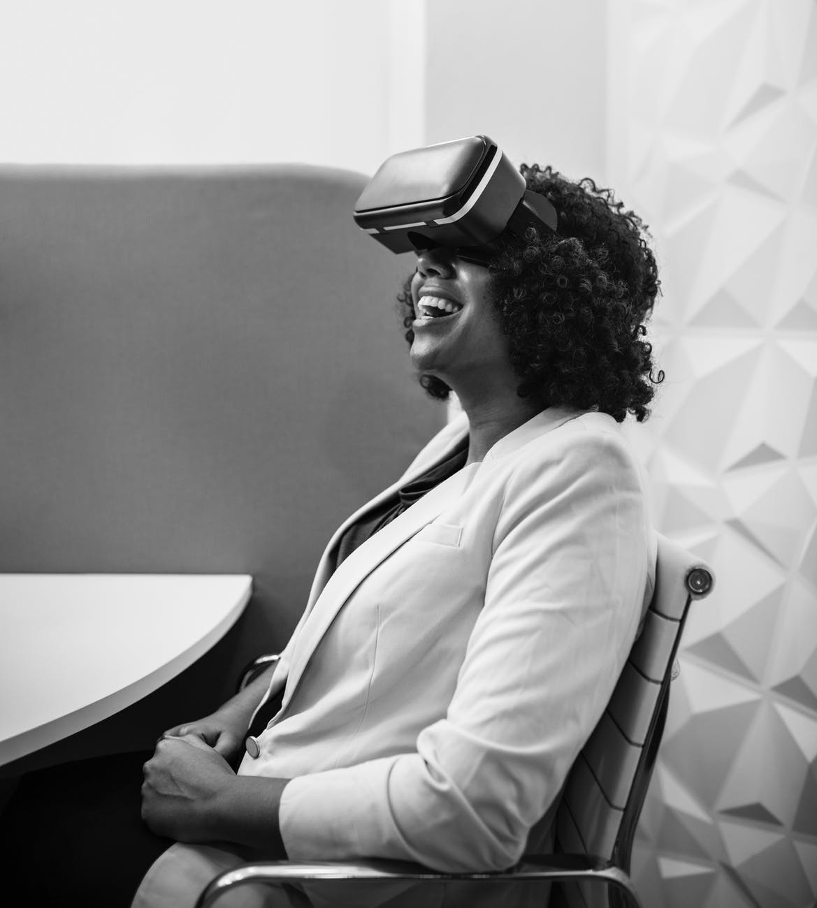 grayscale photography of woman wearing virtual reality headset