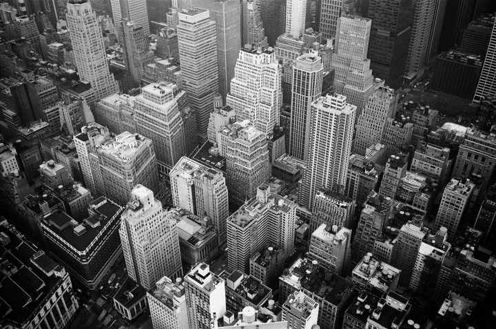 aerial view and grayscale photography of high rise buildings