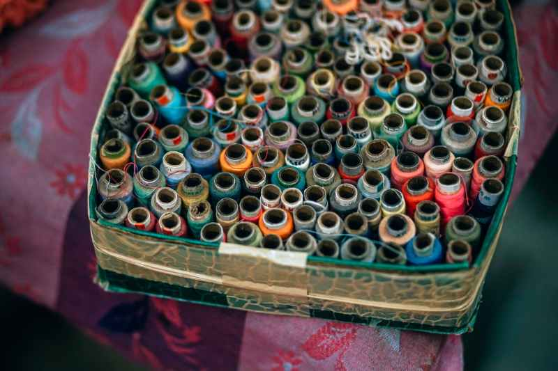 assorted color threads in box