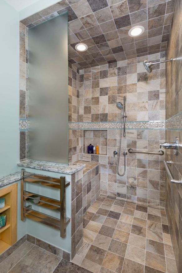 Interior of large walk-in and roll-in shower that is handicapped accessible