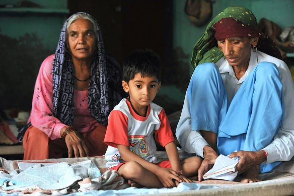 Naveen-age-5-poses-for-a-photograph-with-her-mother-Rajo-Devi-age-75r-and-Umi-Devi-age-60-L-in-Alewa-India
