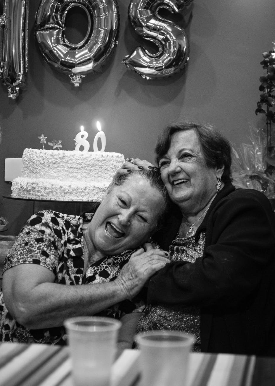 grayscale photography of two laughing women