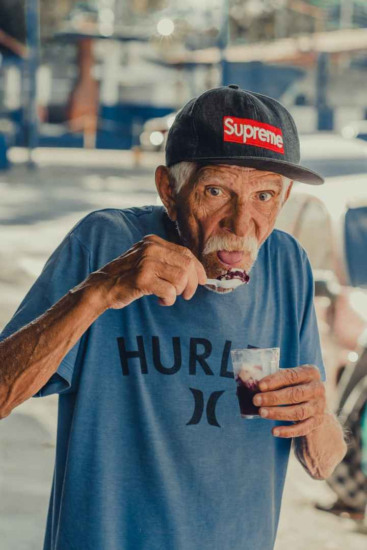 man wearing blue hurley shirt